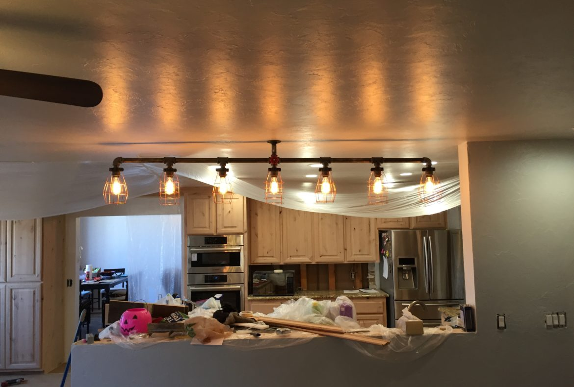 Gas pipe light fixture with copper bulb cages u turn designs